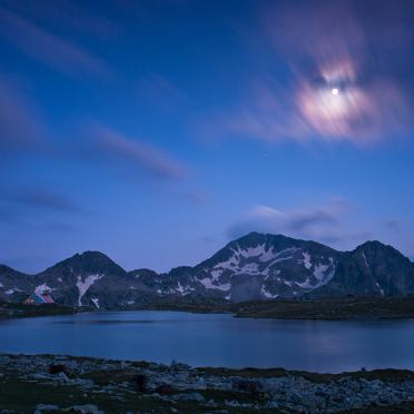 Kamenitza peak and Tevno Ezero lake at moonlight